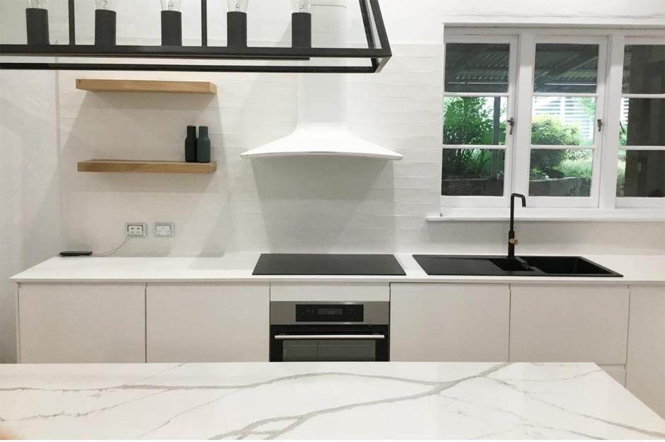 A Black And White IKEA Kitchen With Marble Island Worktop