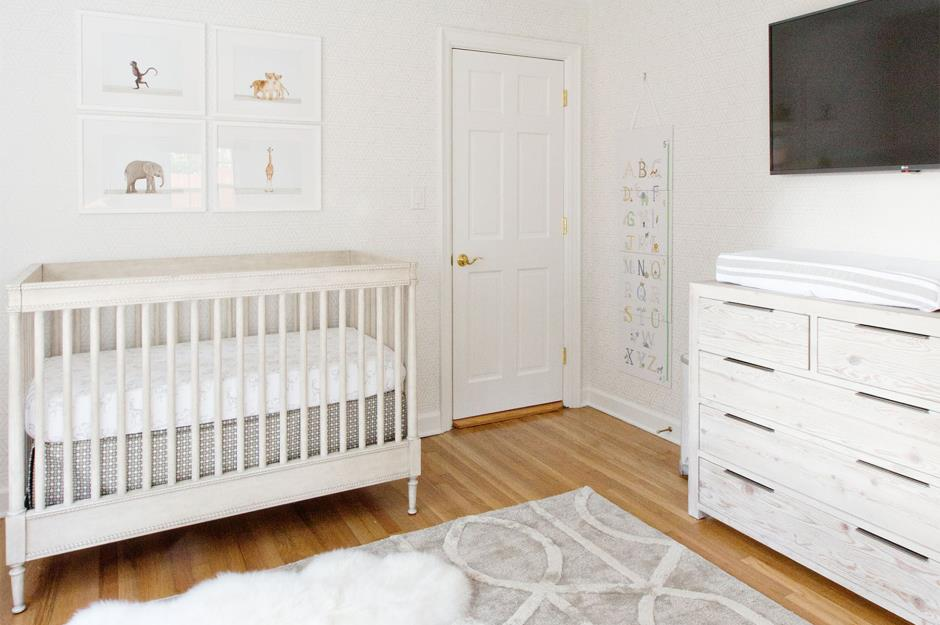 White Gender Neutral Nursery With Crib Changing Table And Television