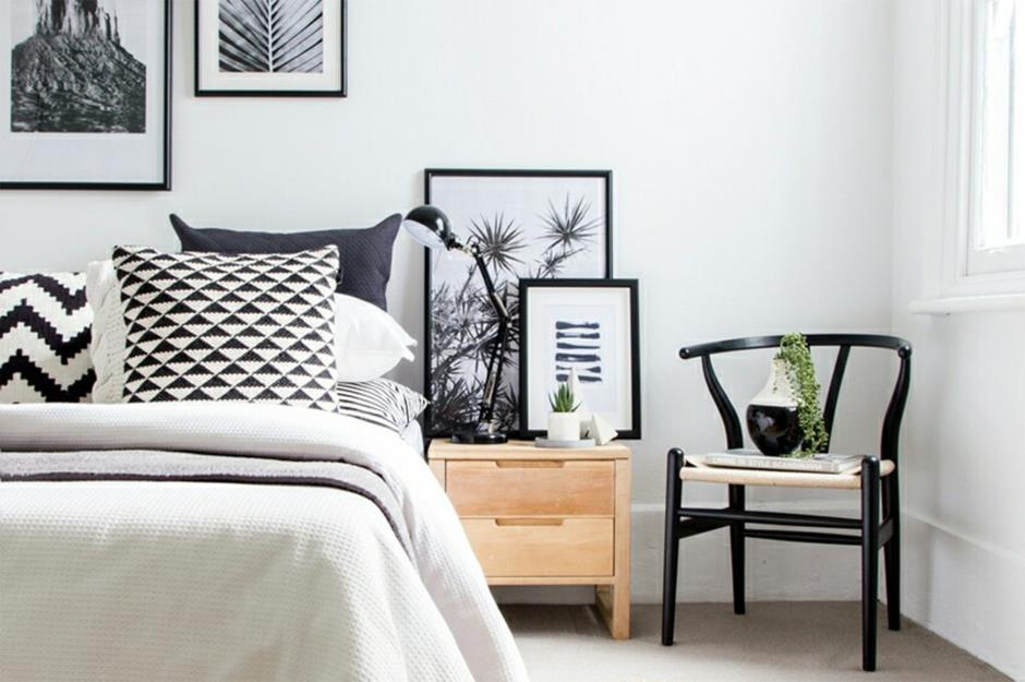 Modern Monochrome Bedroom With Black And White Cushions And Art Prints