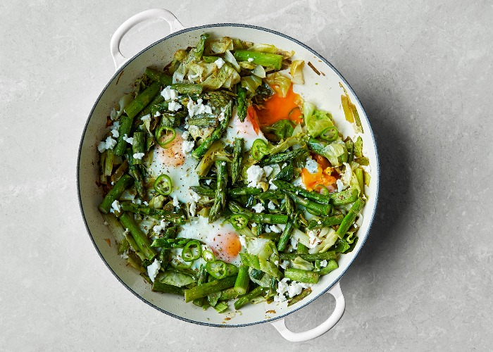 Green baked eggs with asparagus