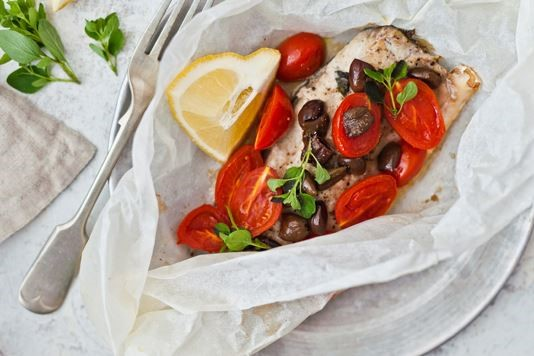 Bass fillet with datterini tomatoes and taggiasche olives recipe