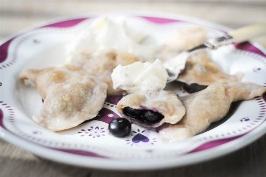 Blueberry 'pierogi' with whipped cinnamon cream recipe