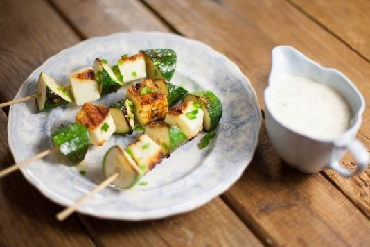 Courgette and halloumi kebabs with a green tahini dressing recipe
