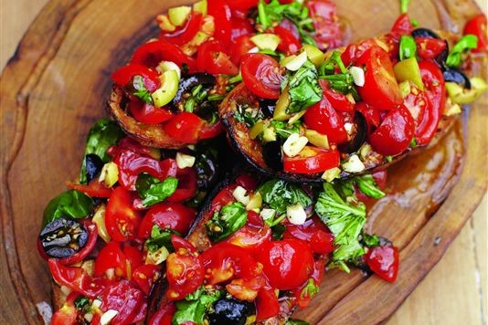 Bruschetta with tomatoes, mozzarella and olives recipe
