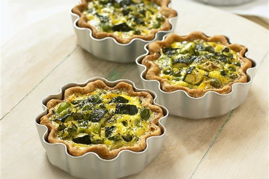 Courgette, broad bean and pea quiches recipe