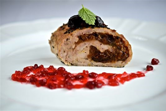 Chicken roulade with prunes, ginger and lingonberry sauce recipe