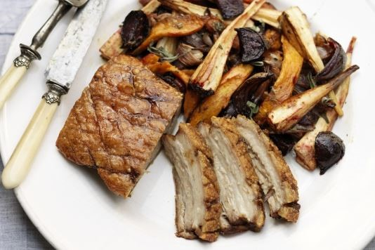 Spiced pork belly with roasted root vegetable salad