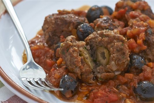 Olive-stuffed beef meatballs with tomato and olive sauce recipe