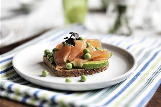Smoked salmon on rye with avocado and peas recipe